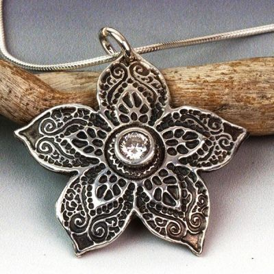 Silver Asian Floral Star Pendant with a Sparkling Cubic Zirconia