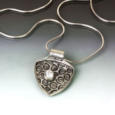 Swirls set in Silver Pendant with Clear CZ